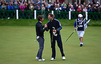 Thorbjorn Olesen of Denmark is congratulated by Florian Fritsch of Germany (R) on the 18th green during the Final Round of the 2015 Alfred Dunhill Links Championship at the Old Course, St Andrews, in Fife, Scotland on 4/10/15.<br /> Picture: Richard Martin-Roberts | Golffile