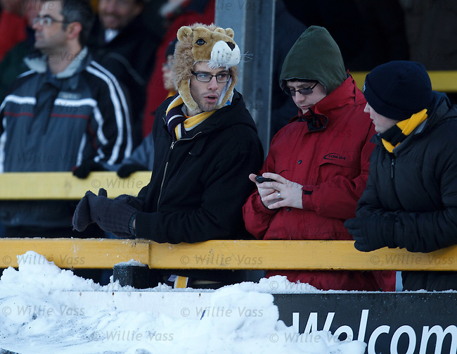 An Alloa fan with warm headgear