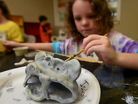 NWA Democrat-Gazette/BEN GOFF @NWABENGOFF<br /> Isabel Treptow, 7, of Cave Springs finishes the gargoyle she made out of modeling clay Friday, July 14, 2017, during ArtCamp: Medieval Adventure at First Presbyterian Church in Rogers. During the five-day camp for rising 1st through 7th graders, students made various art projects inspired by such things as illuminated manuscripts, stained glass windows, relief carving, tapestries and architecture.