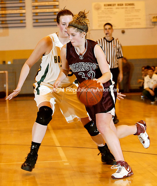 WATERBURY, CT 02/20/08- 022008BZ12- Torrington's Lindsey Begey (32) drives against Holy Cross' Tara Stevenson (33) during the NVL Basketball Championship at Kennedy High School Wednesday night. <br /> Jamison C. Bazinet Republican-American