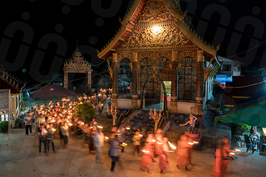 May 10, 2017 - Muang Nan (Laos). Villagers participate in the closure ceremony at the local pagoda. The Boun Bang Fai, or Rocket Festival, is a spectacular, wild and raucous three-day Buddhist celebration of music, dancing, fireworks and the competitive firing of elaborate, homemade rockets. © Thomas Cristofoletti / Ruom