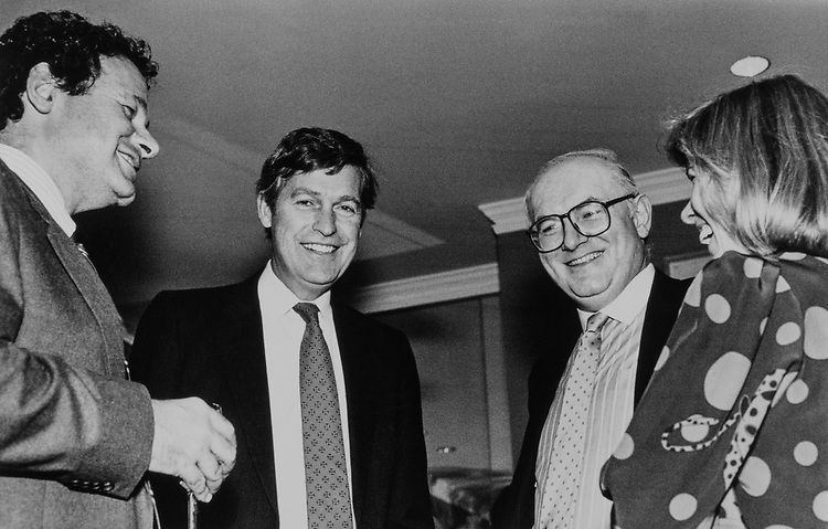 Sen. Tim Wirth, D-Colo. with Steven V. Roberts (U.S. News), William Schneider (The Atlantic) and Kathy Calvin (U.S. News) in 1991. (Photo by Laura Patterson/CQ Roll Call)