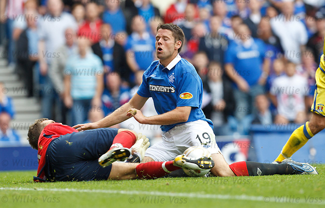 James Beattie collides with goalkeeper Cameron Bell who makes a fine save to deny the new Rangers striker