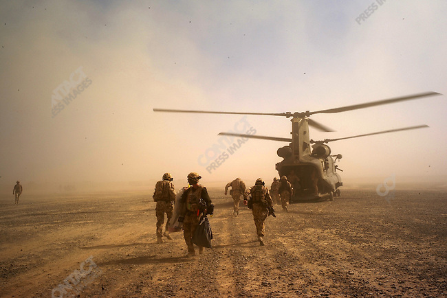 Arriving by Chinook to Garmsir to join up with the Gurkhas. Helmand, Afghanistan, November 2007.