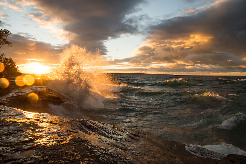 Lake Superior waves crash under a dramatic sky at Pictured Rocks National Lakeshore near Munising, Michigan.