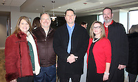 NWA Democrat-Gazette/CARIN SCHOPPMEYER Kelli Gemmell (from left), Sam Hollis, president of Milestone Construction Company attend the grand opening of the Ronald McDonald House Dec. 15 at Washington Regional in Fayetteville.