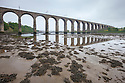Estuarine mud exposed at low tide under the Royal Border Bridge on the River Tweed, Berwick upon Tweed, Northumberland, UK.