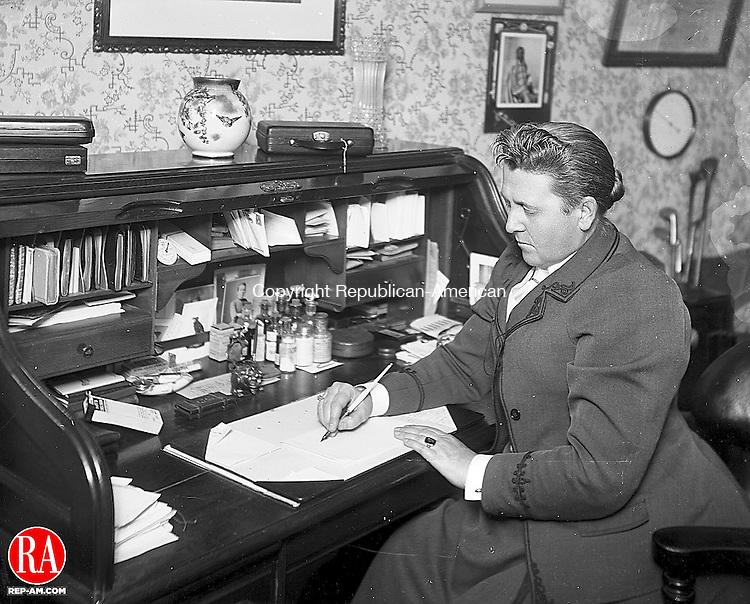 Dr. Caroline R. Conkey, a Waterbury physician in her office at 9 Hillside Avenue, Waterbury, 1890