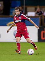 Mike Magee (9) of the Chicago Fire brings the ball forward during a Major League Soccer game at RFK Stadium in Washington, DC.  The Chicago Fire defeated D.C. United, 3-0.