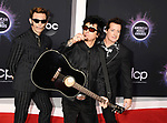 LOS ANGELES, CA - NOVEMBER 24: (L-R) Mike Dirnt, Billie Joe Armstrong and Tré Cool of Green Day attend the 2019 American Music Awards at Microsoft Theater on November 24, 2019 in Los Angeles, California, USA.<br /> CAP/ROT/TM<br /> ©TM/ROT/Capital Pictures