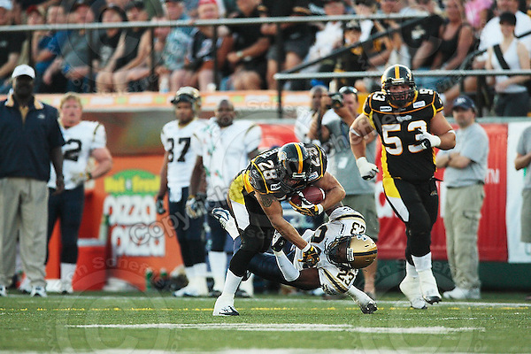 Aug 3, 2007; Hamilton, ON, CAN; Winnipeg Blue Bombers play the Hamilton Tiger-Cats at Ivor Wynne Stadium. The Tiger-Cats defeated the Blue Bombers 43-22. Mandatory Credit: Ron Scheffler. Pictured here is Hamilton Tiger-Cats running back (28) Jesse Lumsden.