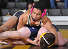 Christian Encarnacion of Wantagh, top,  battles Ryan Resnick of Bethpage at 132 pounds during a Nassau County varsity wrestling match at Wantagh High School on Wednesday, Dec. 19, 2018. Encarnacion won the match by pin.