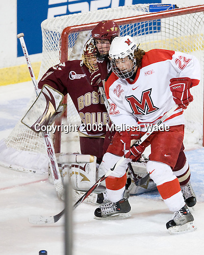 John Muse (BC - 1), Nino Musitelli (Miami - 22), Matt Greene (BC - 14) - The Boston College Eagles defeated the Miami University Redhawks 4-3 in overtime on Sunday, March 30, 2008 in the NCAA Northeast Regional Final at the DCU Center in Worcester, Massachusetts.
