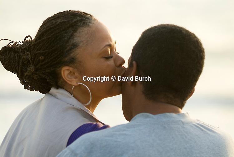 Mature woman kissing man, close-up