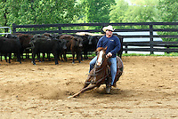 Cowboys cutting with horse on farm in Albemarle County, Va.  Credit Image: © Andrew Shurtleff