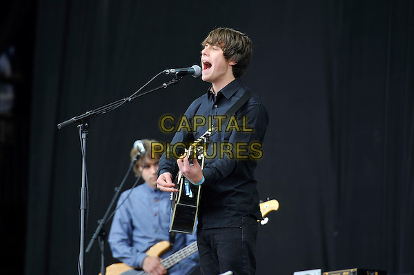 Jake Bugg<br /> performing at Glastonbury Festival, Worthy Farm, Pilton, Somerset, <br /> England, UK, 28th June 2013.<br /> live on stage music concert gig half length playing guitar singing microphone navy blue black shirt <br /> CAP/MAR<br /> &copy; Martin Harris/Capital Pictures