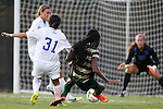 31 August 2014: UAB's Kimberly Fincher (12) scores a goal past Duke's Christina Gibbons (31), EJ Proctor (30), and Lizzy Raben (behind, left). The Duke University Blue Devils hosted the University of Alabama Birmingham Blazers at Koskinen Stadium in Durham, North Carolina in a 2014 NCAA Division I Women's Soccer match. Duke won the game 3-1.