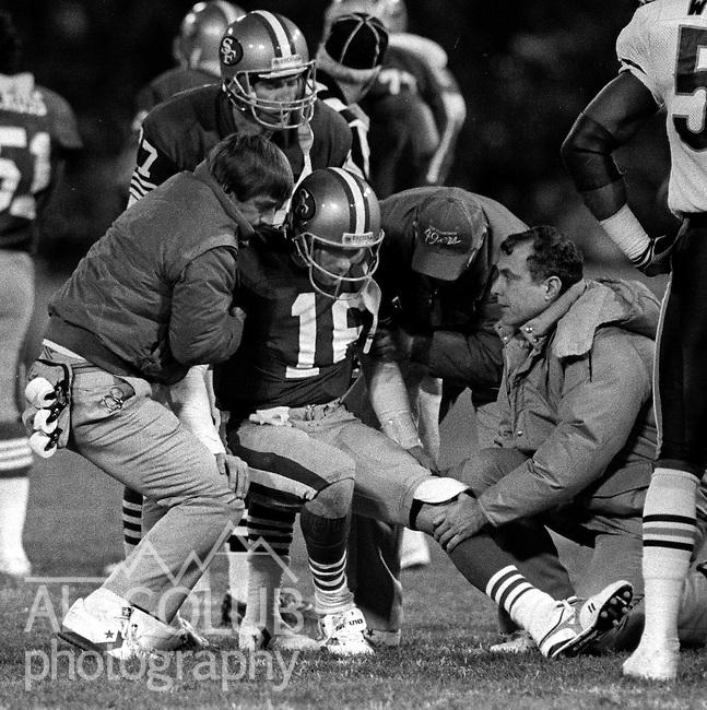 San Francisco 49ers vs Chicago Bears at Candlestick Park Monday, December 14, 1987..49ers Beat Bears 41-0.San Francisco 49ers Quarterback Joe Montana (16) helped off field after injury...