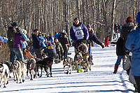 Mats Pettersson and team run past spectators on the bike/ski trail during the Anchorage ceremonial start during the 2014 Iditarod race.<br /> Photo by Britt Coon/IditarodPhotos.com