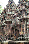 Angkorian temple Banteay Srei (late 10th century) 967.<br /> Doorway into the northern sanctuary tower.<br /> Three sanctuary towers.The central sanctuary and the southern sanctuary were dedicated to Shiva and the northern sanctuary was dedicated to Vishnu.<br /> Banteay Srei temple is situated 20km north of Angkor, built during the reign of Rajendravarman by Yajnavaraha, one of his counsellors. In antiquity Isvarapura was a small city that grew up around the temple. Banteay Srei was dedicated to the worship of Shiva, the foundation stele describes the consecration of the linga Tribhuvanamahesvara (Lord of the three worlds) in 967.