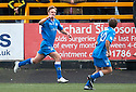 Queen of the South's Iain Russell (left) celebrates after he scores their first goal.