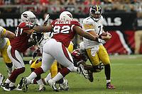 10/23/11 Glendale, AZ: Pittsburgh Steelers quarterback Ben Roethlisberger #7 and Arizona Cardinals nose tackle Dan Williams #92 during an NFL game played at University of Phoenix Stadium between the Arizona Cardinals and the Pittsburgh Steelers. The Steelers defeated the Cardinals 32-20.