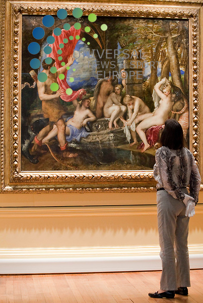 Patricia Collins, curator of medieval and renaissance art, studies Titian's Diana and Actaeon which was unveiled at Kelvingrove Art Gallery today. The painting was bought for £50million from the Duke of Sutherland for the nation by the National Galleries of Scotland and the National Gallery in London in February 2009, following a large scale public and private fundraising campaign  Johnny Mclauchlan/Universal News and Sport (Scotland). 01/07/10..