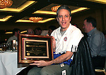 "Jon Stewart, host of Comedy Central's ""The Daily Show"" shows off his plaque declaring him to be an NSCAA Honorary All-America on Saturday, January 21st, 2006, during the National Soccer Coaches Association of America's annual convention in the Grand Ballroom of the Pennsylvania Convention Center in Philadelphia, PA."