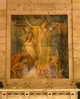 On the wall of the Gallaria delle Bibite a tiled mural illustrates the benefits of the thermal water on a woman's beauty