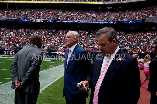 Houston, Texas<br /> October 2, 2011<br /> <br /> Team owner Bob McNair (blue jacket) with son Cary McNair (black jacket) and general manager and first as executive vice president, Rick Smith (grey jacket) on the sidelines as the game is played. <br /> <br /> The Houston Texans defeated the Pittsburgh Steelers at the Reliant Stadium 17 to 10.
