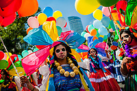 Mexican girls, wearing colorful costumes and having their faces painted, walk on the street during the Day of the Dead festival in Mexico City, Mexico, 29 October 2016. Day of the Dead (Día de Muertos), a syncretic religious holiday combining the death veneration rituals of the ancient Aztec culture with the Catholic practice, is celebrated throughout all Mexico. Based on the belief that the souls of the departed may come back to this world on that day, people gather at the gravesites in cemeteries praying, drinking and playing music, to joyfully remember friends or family members who have died and to support their souls on the spiritual journey.