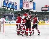 Kevin Roy (NU - 15), Matt Benning (NU - 5), John Stevens (NU - 18), Braden Pimm (NU - 14) - The Northeastern University Huskies defeated the University of Massachusetts Lowell River Hawks 4-1 (EN) on Saturday, January 11, 2014, at Fenway Park in Boston, Massachusetts.
