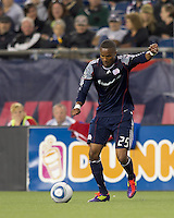 New England Revolution defender Darrius Barnes (25) passes the ball. In a Major League Soccer (MLS) match, the New England Revolution defeated FC Dallas, 2-0, at Gillette Stadium on September 10, 2011.