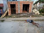 A drunk man sleeps on the street in Atalaia do Norte in Brazil's Amazon region.