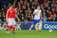 Filip Kostic of Serbia runs at the Wales defence during the FIFA World Cup Qualifying match between Wales and Serbia at the Cardiff City Stadium, Cardiff, Wales on 12 November 2016. Photo by Mark  Hawkins.
