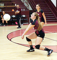 Photo by Randy Moll<br /> Haley Borgeteien-James, Gentry senior, receives a serve during play against Shiloh Christian at Gentry High School on Thursday, Sept. 10, 2015. Yulianna Stasiv and Coach Greg Johnson are in the background.