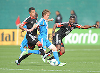 Brian Carroll (7) of the Philadelphia Union goes against Marcelo Saragosa (11) of D.C. United. The Philadelphia Union defeated D.C. United 3-2, at RFK Stadium, Sunday April 21, 2013.