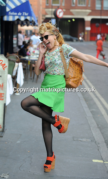 NON EXCLUSIVE PICTURE: PALACE LEE / MATRIXPICTURES.CO.UK<br /> PLEASE CREDIT ALL USES<br /> <br /> WORLD RIGHTS<br /> <br /> English pop singer Paloma Faith is spotted walking through London's Soho.<br /> <br /> JULY 8th 2013<br /> <br /> REF: LTN 134676