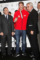 Real Madrid player Sergio Ramos (c) and the President Florentino Perez participate and receive new Audi during the presentation of Real Madrid's new cars made by Audi at the Jarama racetrack on November 8, 2012 in Madrid, Spain.(ALTERPHOTOS/Harry S. Stamper) .<br />