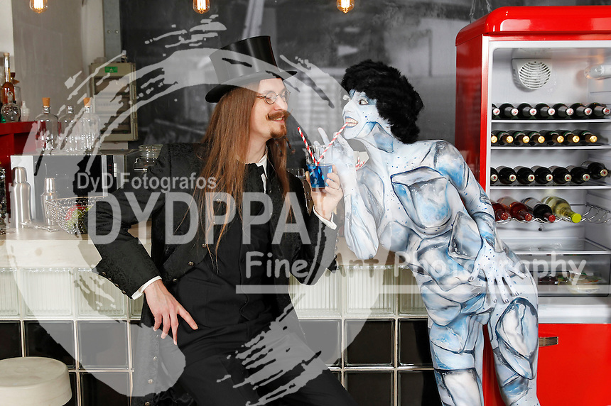 Door Art: Fridge door bodypainting with model Barbara as ice cubes and Colin as guest in a private apartment in Hanover on December 20, 2015 - A project of body paint artist J�rg D�sterwaald and the photographer Tschiponnique Skupin