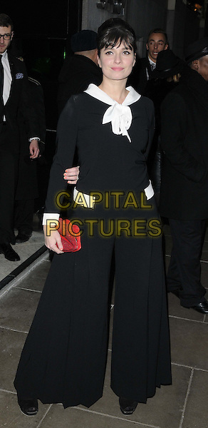 Gizzi Erskine.attended the BRIT Awards 2013 Warner Brothers afterparty, The Savoy Parlour Room, Savoy Hotel, The Strand, London, England..February 20th, 2013.full length black white red jumpsuit pussybow wide leg flared clutch bag.CAP/CAN.©Can Nguyen/Capital Pictures.