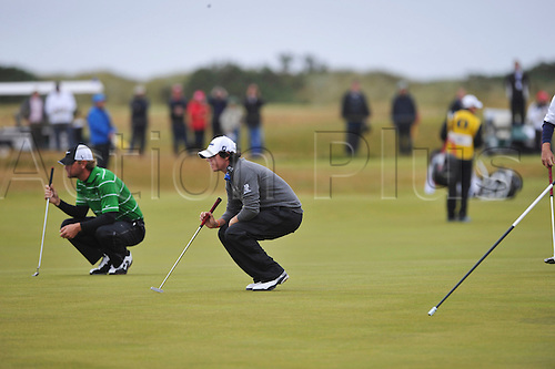 15/07/10 Rory McIlroy (IRL) and Nick Watney (USA) eye up puts on the Old Course , St  Andrews, Fife, Scotland in the first round of  British Open Championship