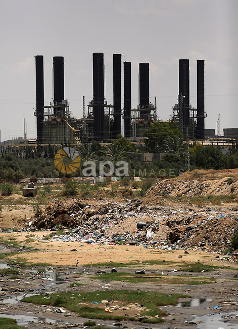 A general view of Gaza's power plant in Nusseirat, in the central Gaza Strip on June 21, 2017. Egypt began to deliver a million litres of fuel to Gaza, a Palestinian official said, in an attempt to ease the Palestinian enclave's desperate electricity crisis. The fuel, trucked in through the Rafah border between Egypt and Gaza, will be routed to the territory's only power station -- closed since April due to fuel shortages. Photo by Ashraf Amra