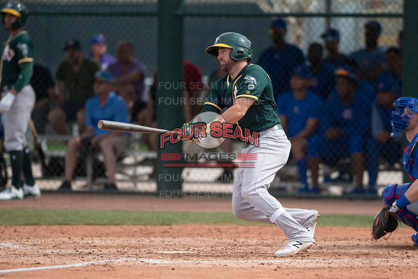 Oakland Athletics second baseman J.P. Sportman (21) follows through on his swing during a Minor League Spring Training game against the Chicago Cubs at Sloan Park on March 13, 2018 in Mesa, Arizona. (Zachary Lucy/Four Seam Images)