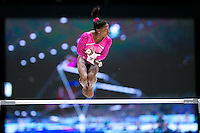 Simone Biles dismounts off uneven bars during all around finals at 2013 Worlds Gymnastics in Antwerp, Belgium.  2013 Worlds Artistic Gymnastics Championships