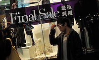 "Shoppers pass a ""Final Sale"" sign in Causeway Bay, Hong Kong. Hong Kong's slumping economy will shrink further in the first half of 2009.."