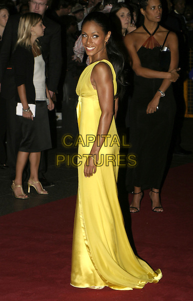 JADA PINKETT SMITH.Collateral UK premiere, UCI Empire, Leicester Square, London, 2nd September 2004..full length long yellow satin dress ribbon bow.Ref: AH.www.capitalpictures.com.sales@capitalpictures.com.©Capital Pictures.