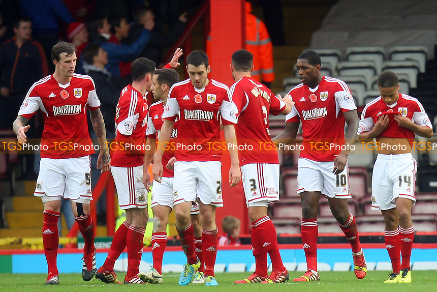 Jay Emmanuel-Thomas of Bristol City (10) is congratulated after scoring the opening goal -  Bristol City vs Dagenham and Redbridge at the Ashton Gate Stadium - 09/11/13 - MANDATORY CREDIT: Dave Simpson/TGSPHOTO - Self billing applies where appropriate - 0845 094 6026 - contact@tgsphoto.co.uk - NO UNPAID USE
