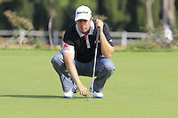 Ryan Evans (ENG) lines up his putt on the 14th green during Thursday's Round 1 of the 2016 Portugal Masters held at the Oceanico Victoria Golf Course, Vilamoura, Algarve, Portugal. 19th October 2016.<br /> Picture: Eoin Clarke | Golffile<br /> <br /> <br /> All photos usage must carry mandatory copyright credit (&copy; Golffile | Eoin Clarke)