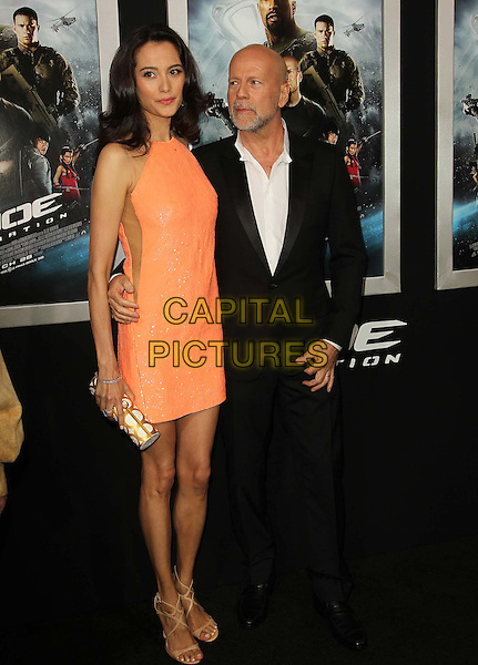 "Emma Heming & Bruce Willis .""G.I. Joe: Retaliation"" Los Angeles Premiere held at TCL Chinese Theatre, Hollywood, California, USA..March 28th, 2013 .full length beard facial hair black white shirt suit orange coral married husband wife dress clutch bag shiny gold side panel sheer.CAP/ADM/KB.©Kevan Brooks/AdMedia/Capital Pictures."